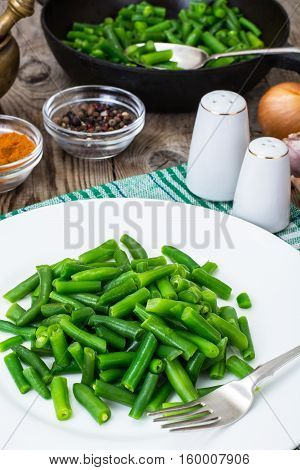 Salad of green beans on white plate. Studio Photo