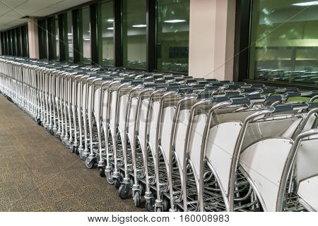 luggage carts at airport terminal
