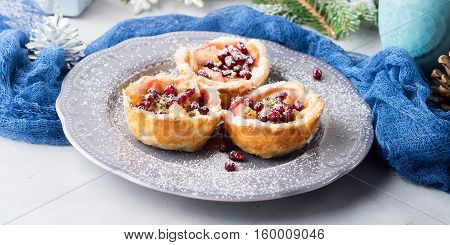 Christmas Mini Apple Pies With Pomegranate Seeds. Banner