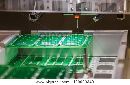Electronic printed circuit Board on table of robot machine