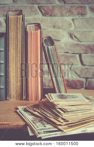 Old family photo albums and a stack of photos