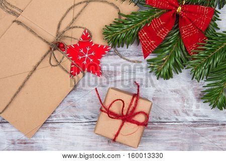 Christmas Gifts, Letters And Fir Branch With Red Bow