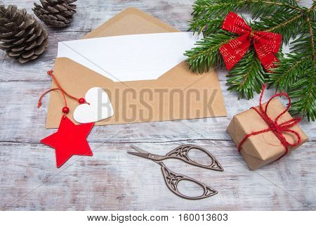 Envelope For Christmas Letter On Table With Spruce Branches
