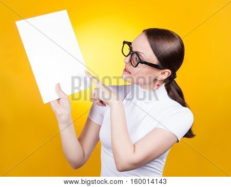 Portrait Of A Woman With Glasses  Holding A Poster