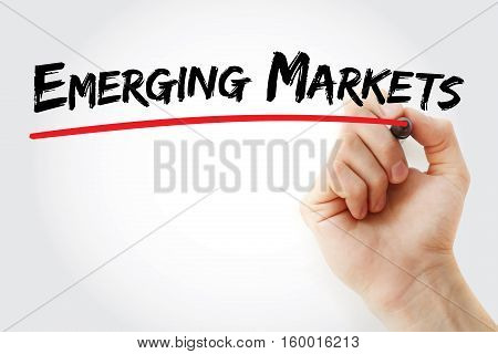 Hand Writing Emerging Markets With Marker