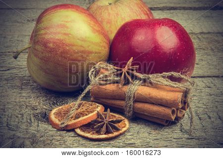Apples And Christmas Spices On Wooden Rustic Background. Soft Toning Effect