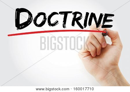 Hand Writing Doctrine With Marker