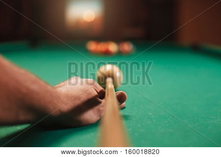 Man preparing to break spheres in billiards.