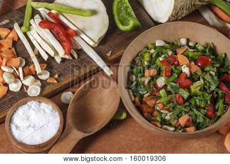glued chopped vegetables on kitchen boardand. Chopped vegetables