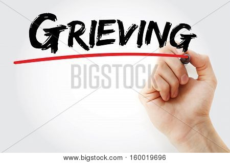 Hand Writing Grieving With Marker