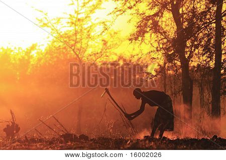 African Woman Provide Food At Dawn