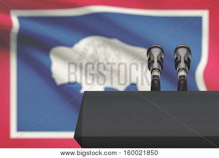Pulpit And Two Microphones With Usa State Flag On Background - Wyoming