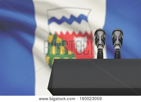 Pulpit And Two Microphones With Canadian Province Flag On Background - Northwest Territories
