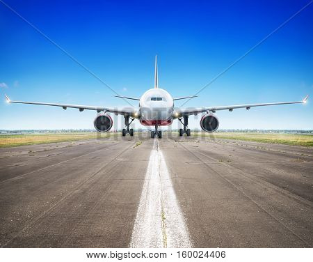 airliner on a runway ready for take off