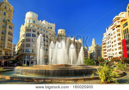 Valencia, Spain - October 29, 2016: Fountain on the Plaza del Ayuntamiento or the Modernisme Plaza of the City Hall of Valencia
