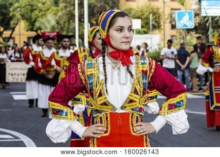 SELARGIUS, ITALY - September 13, 2015: Former marriage Selargino - Sardinia - portrait of a beautiful girl in the folk group Sant'Antonio Abate of Desulo