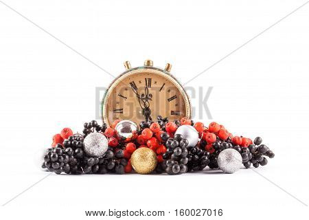 Ripe red and black rowan isolated on white background. Clock and christmas ball