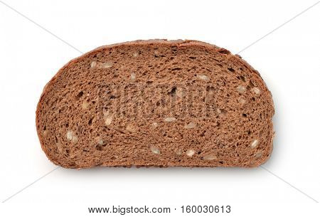 Slice of wholegrain rye bread with bran and seeds isolated on white