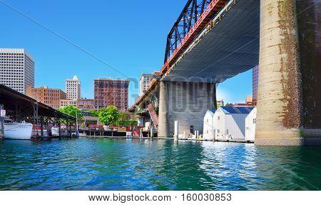 Tacoma Downtown City Marina With Houses Under Large Bridge