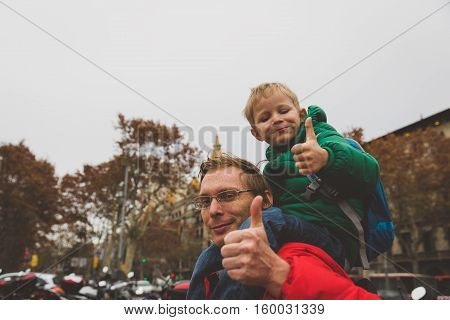 father and little son travel in Barcelona, Spain, Europe