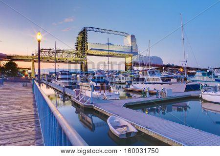 Tacoma Downtown Marina With Bridge And Pier.
