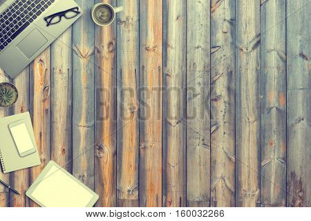 Top View Of A Laptop On Old Wooden Table Background.office Supplies, Gadgets, Coffee, Smartphone, Ta