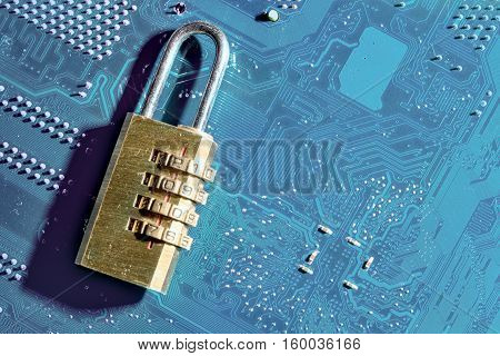 Computer Security Threats In 2017. Padlock With The Code Combination 2017 Is On A Computer Motherboa