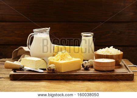 Assorted dairy products (milk, yogurt, cottage cheese, sour cream) rustic still life