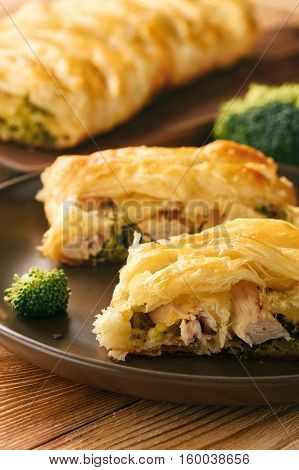 Homemade pie stuffed with broccoli, chicken and cheese.
