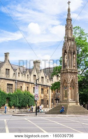 Oxford United Kingdom - June 20 2006: Martyrs Memorial just outside Balliol College is a stone monument was built 300 years after the events of the English Reformation. People walking on an historic street in central Oxford.