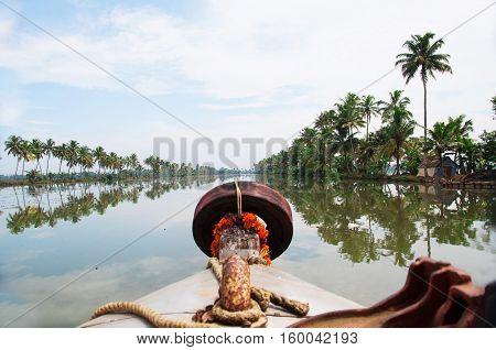Boat travel in a asian water channel in Kerala