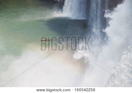 Kayaking  at a beautiful waterfall with a canoe