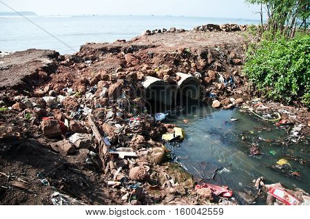 City sewer flowing at a sea, pollution