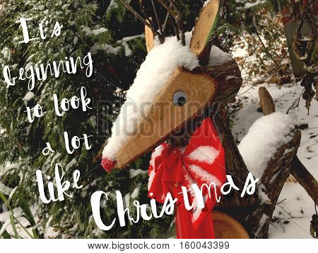 Vintage Christmas Card with Red Nose Reindeer In fresh falling snow with written words