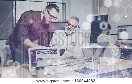 Concept of digital screen, virtual connection icon, diagram, graph interfaces.Presentation new business project.Bearded young man hands pointing to screen modern laptop.Horizontal, flare