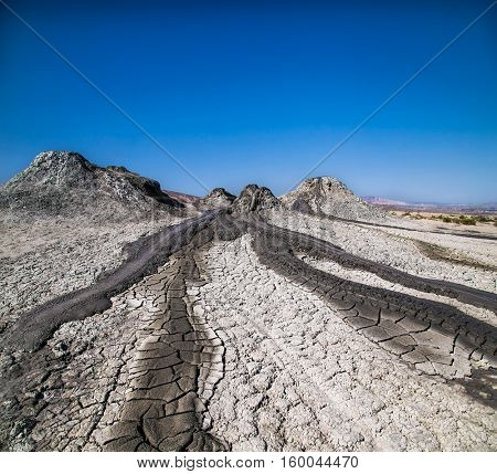 Field with craters of mud volcano in Gobustan and eruption mud. Azerbaijan.