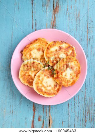 Syrniki (Cottage cheese pancakes Fritters of cottage cheese) traditional Ukrainian and Russian cuisine.