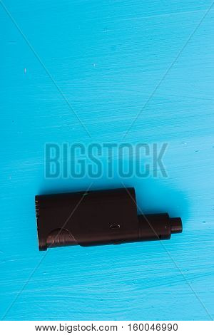 E-cigarette or vaping device on blue background