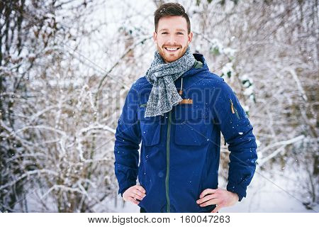 Cheerful Male In Coat On Winter Background