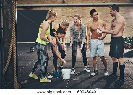 Men And Women Putting Talc Powder On Hands