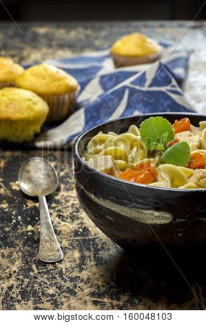 fresh made hot chicken noodle soup with cornbread muffins