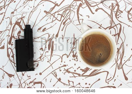 Vaping set and coffee on art painted cackground. Creative person or bussinesman style