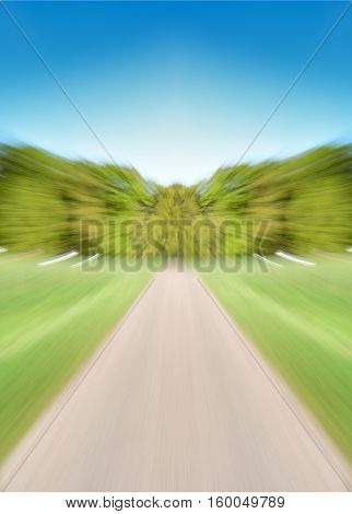 Empty road with motion blur converging on a tree lined horizon