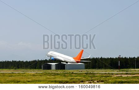 Airliner taking off from an airport runway