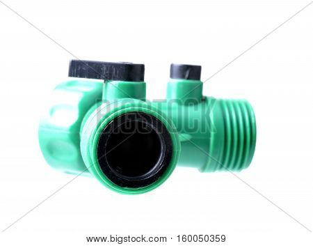 Garden hose two way shut off plastic adapter isolated on white