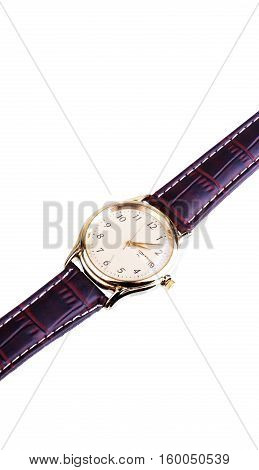 Close up shot of a traditional wrist watch with a leather band isolated on white