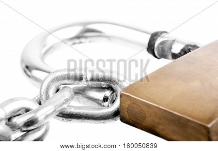 Macro shot of a chain and a big old lock isolated on white