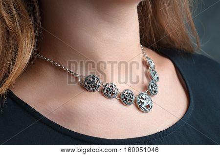silver ethnic jewelry necklace on woman, Beautiful Necklace in focus.