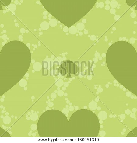 seamless pattern. EPS 10 vector illustration. used for printing websites design interior fabrics etc. spades and a green card heart suit on a green background with bright circles.