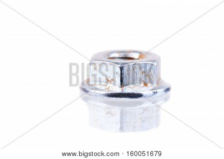 Macro shot of a screw nut with rust spots and reflection isolated on white
